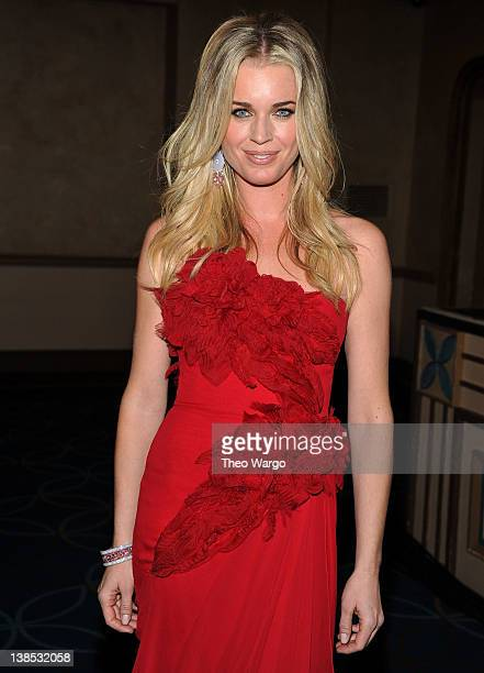 Model Rebecca Romijn prepares backstage at The Heart Truth's Red Dress Collection 2012 Fashion Show at Hammerstein Ballroom on February 8 2012 in New...