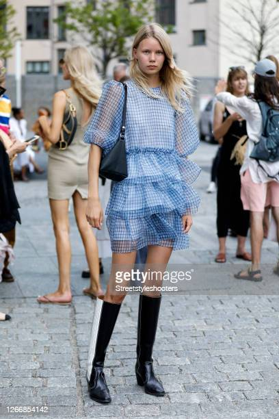 Model Rebekka Eriksen, wearing a transparent blue dress with quillings by Ganni during Copenhagen Fashion Week Spring/Summer 2021 outside the...