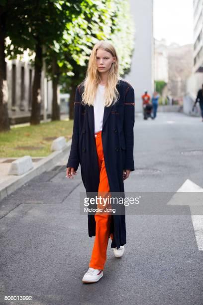 Model Rebekka Eriksen wears orange pants after the Rodarte show on July 2 2017 in Paris France