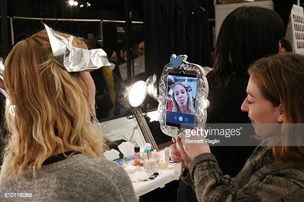 A model records a GIF backstage at Monique Lhuillier Fall 2016 New York Fashion Week at The Arc Skylight at Moynihan Station on February 13 2016 in...