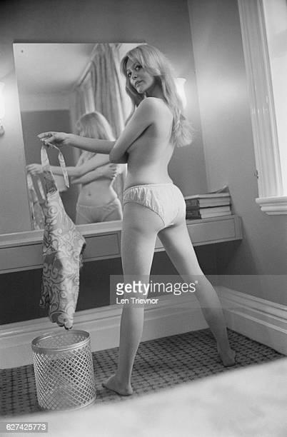 Model Reena Brown drops a disposable mini dress into a bin 5th April 1971