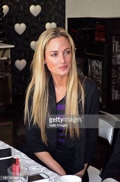 Model Reeva Steenkamp attends her high tea birthday party at the Da Vinci Hotel on August 12, 2012 in Sandton, South Africa. Oscar Pistorius stands...