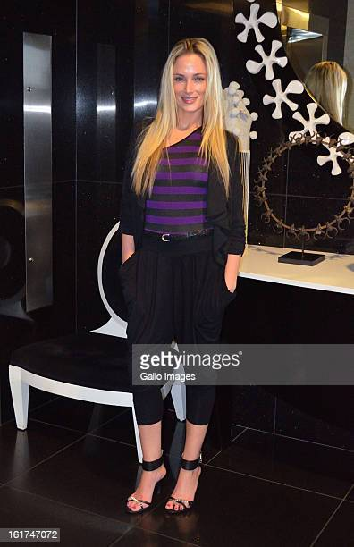 FHM model Reeva Steenkamp attends her high tea birthday party at the Da Vinci Hotel on August 12 2012 in Sandton South Africa Oscar Pistorius stands...