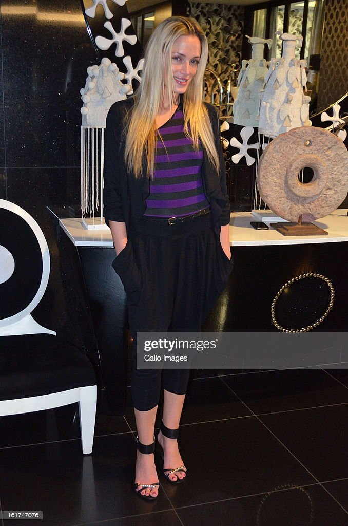FHM model Reeva Steenkamp attends her high tea birthday party at the Da Vinci Hotel on August 12, 2012 in Sandton, South Africa. Oscar Pistorius stands accused of murder after shooting girlfriend Reeva Steenkamp on the morning of February 14, 2013. His bail hearing has been postponed until February 19, 2013, with prosecutors stating they will pursue a charge of premeditated murder against him.