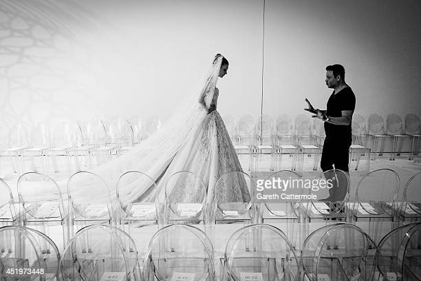 Model rehearses on the catwalk before the Zuhair Murad show as part of Paris Fashion Week - Haute Couture Fall/Winter 2014-2015 at Palais Des Beaux...