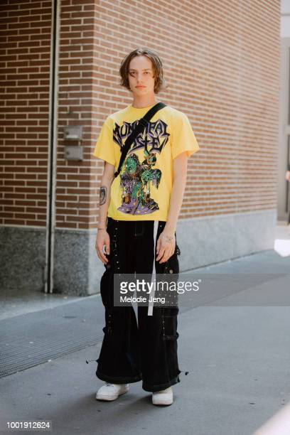 Model Reilly Patton wears a yellow Monster graphic tshirt black raver pants with pockets and studs white Air Force 1 Nike sneakers after the Fendi...
