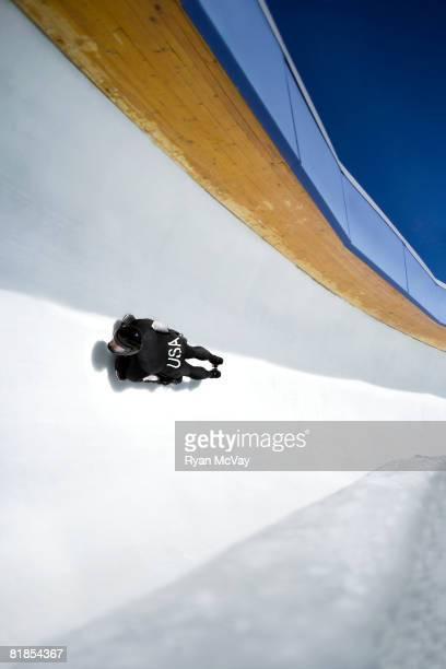 Model Released Bobsled/Skeleton: Man on skeleton sled down ice track, high angle view, at Utah Olympic Park, Utah
