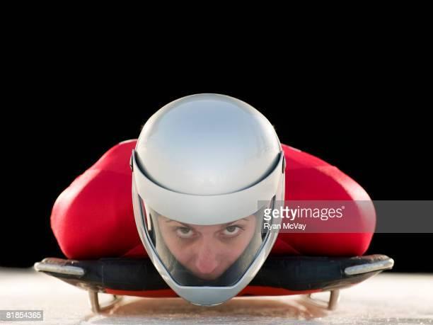 Model Released Bobsled/Skeleton: Portrait of female skeleton athlete wearing crash helmet on sled at Utah Olympic Park, Utah.