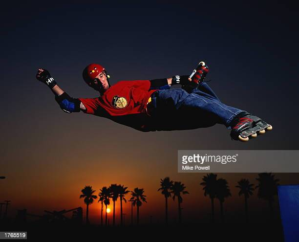 Inline skater in midjump sunset