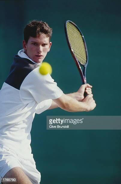 Male tennis player preparing to hit ball closeup