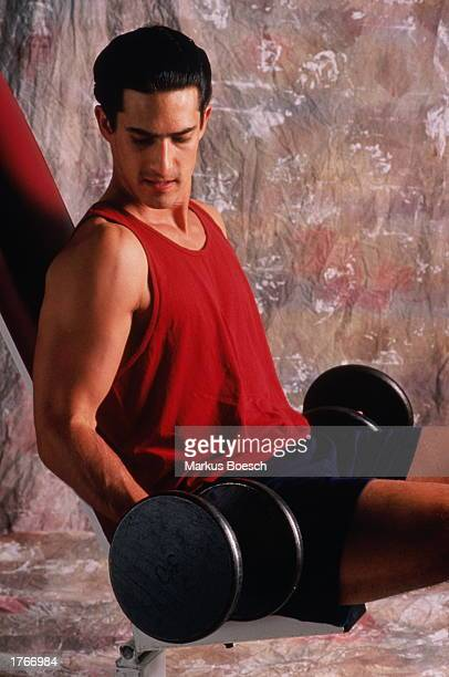Man doing arm curls using dumbells