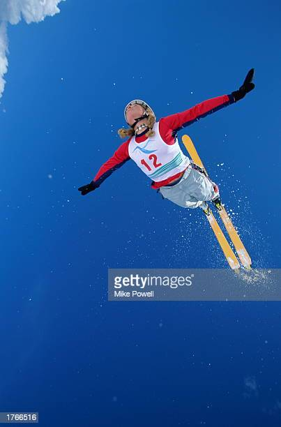 Skier in midair jump arms out at sides