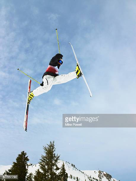 Skier doing freestyle jump in air at Mammoth Mountain Ski Resort in Mammoth Lakes California