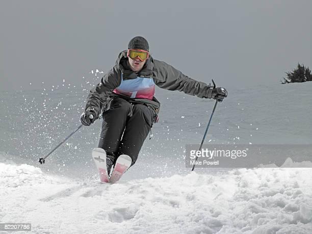 Skier skiing down slope at Mammoth Mountain Ski Resort in Mammoth Lakes California