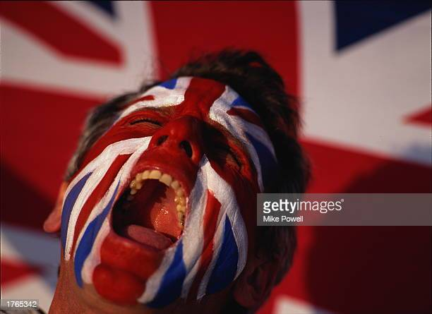 Sports fan shouting, United Kingdom flag painted on face