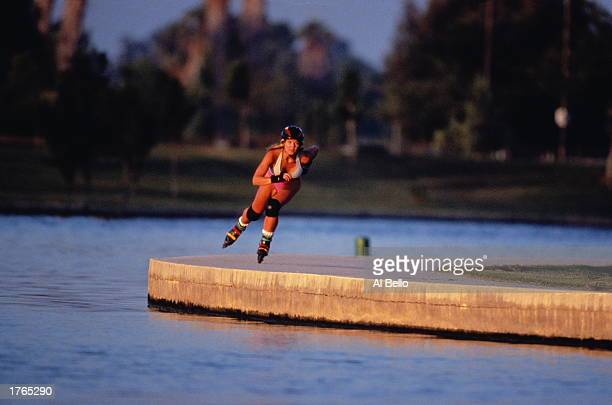 Woman inline skating beside lake