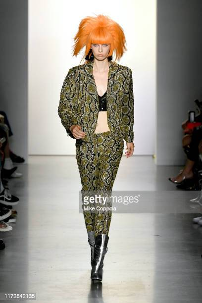 A model Remington Williams walks the runway for Jeremy Scott during New York Fashion Week The Shows at Gallery I at Spring Studios on September 06...
