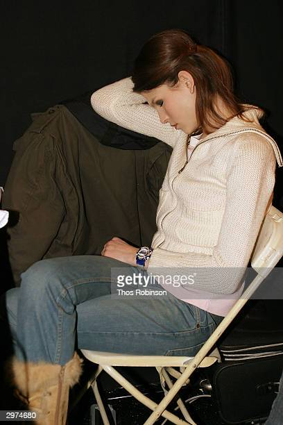 A model rests backstage at the Jeffrey Chow Fall 2004 during Olympus Fashion Week February 12 2004 in New York City