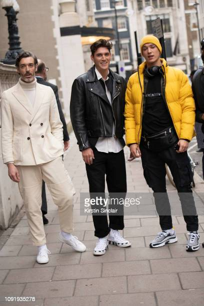 Model Richard Biedul wearing Oliver Spencer with Harrys of London trainers model Isaac Carew wearing a Lewis Leathers jacket and Off White trainers...
