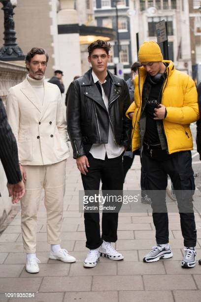 Model Richard Biedul wearing Oliver Spencer with Harrys of London trainers, model Isaac Carew wearing a Lewis Leathers jacket and Off White trainers,...