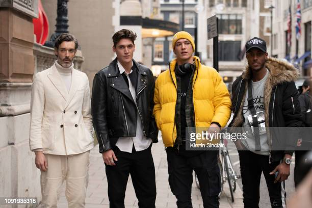 Model Richard Biedul wearing Oliver Spencer with model Isaac Carew wearing a Lewis Leathers jacket model and musician Aaron Unknown wearing a Tommy...