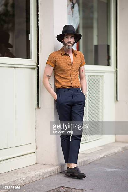 Model Richard Biedul wears a Joshua Kane hat Percival menswear shirt Mansolutely pants and Oliver Sweeney shoes on June 24 2015 in Paris France