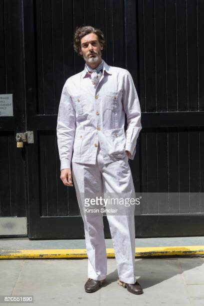 Model Richard Biedul wears a Richard James suit and a vintage scarf on day 3 of London Collections Men on June 11 2017 in Paris France