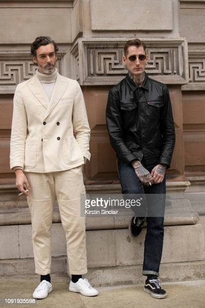 Model Richard Biedul wears Oliver Spencer with Harrys of London trainers with Model Dan Felton wearing a Levi's jacket and jeans during London...