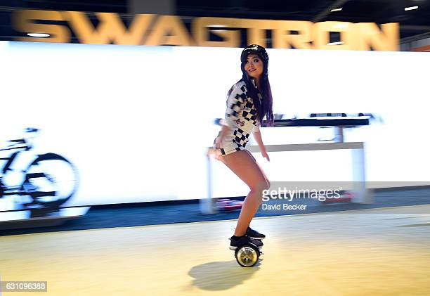 A model rides a Swagtron T3 hoverboard at CES 2017 at the Las Vegas Convention Center on January 6 2017 in Las Vegas Nevada CES the world's largest...