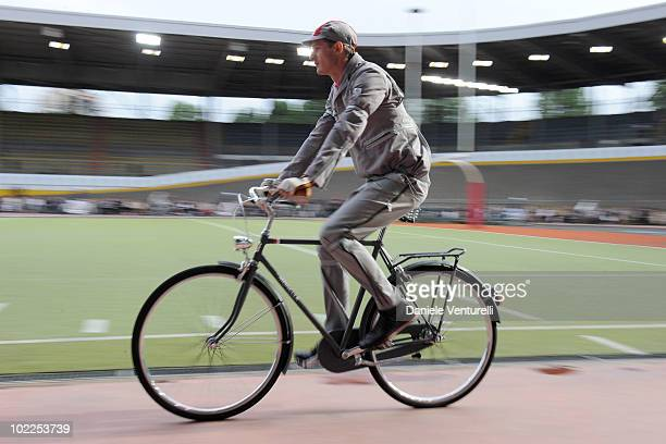 Model rides by bike the runway in the Moncler Gamme Bleu show during Milan Fashion Week for Menswear Spring/Summer 2011 on June 20, 2010 in Milan,...
