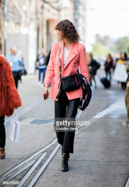 Model Roberta Pecoraro wearing pink blazer cropped leather pants Prada bag during MercedesBenz Fashion Week Resort 19 Collections at Carriageworks on...