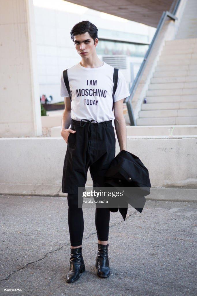 Model Rodrigo Laguna wears Zara trousers, Moschino t-shirt, Zara Jacket and H&M handbag at Ifema during Mercedes Benz Fashion Week Madrid Autumn / Winter 2017 on February 20, 2017 in Madrid, Spain.
