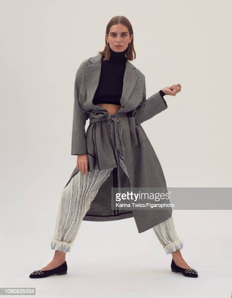 Model Romane Greze poses at a fashion shoot for Madame Figaro on September 12 2018 in Paris France Trench sweater Emilio Puccis jeans shoes PUBLISHED...