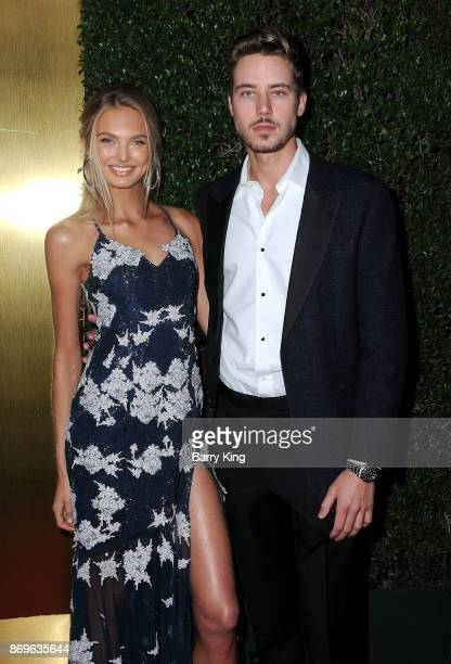 Model Romee Strijd and actor Cameron Fuller attend #REVOLVEawards at DREAM Hollywood on November 2 2017 in Hollywood California