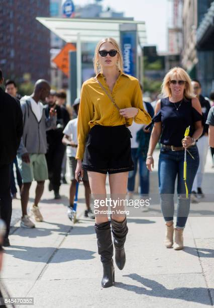 Model Romee Strijd wearing mustard button shirt black shorts seen in the streets of Manhattan outside Public School during New York Fashion Week on...