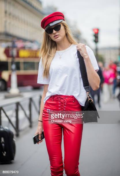 Model Romee Strijd wearing red flat hat white tshirt Fendi bag red leather pants white boots is seen outside Balmain during Paris Fashion Week...