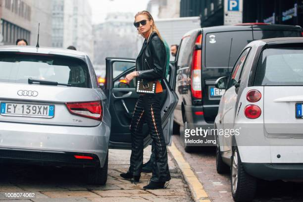 Model Romee Strijd wears black sunglasses a black leather motorcycle jacket black leather pants with slits after the Sport Max show during Milan...