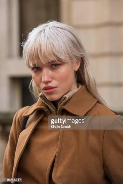 Model Ronja Susi wears a burnt orange wool coat during London Fashion Week February 2020 on February 18 2020 in London England