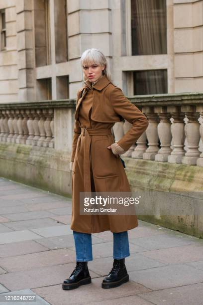 Model Ronja Susi wears a burnt orange wool coat Naked jeans and Dr Martens boots during London Fashion Week February 2020 on February 18 2020 in...
