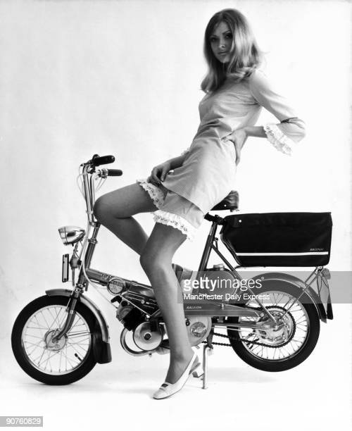 Model Rosaleen Murray wears a checked cycling outfit with lacetrimmed shorts At the time bicycles were required to be licenced