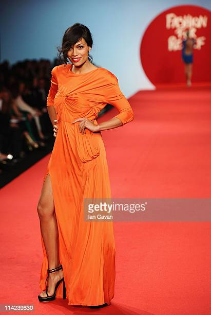 Model Rosario Dawson walks the runway at the Fashion For Relief at Forville market during the 64th Annual Cannes Film Festival on May 16, 2011 in...