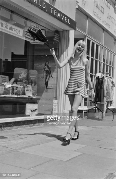 Model Rosemary Clarke wearing a striped mini-dress on the King's Road in Chelsea, London, UK, 21st June 1974.