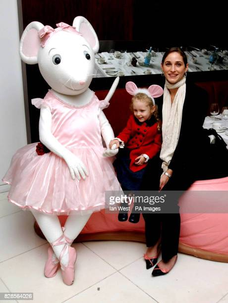 Model Rosemary Ferguson and Elfie pose with children's TV star Angelina Ballerina during the Nutcracker premiere preperformance party at the Coliseum...