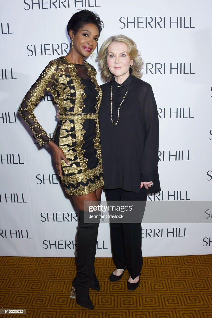 Model Roshumba Williams and designer Sherri Hill prepares backstage during the NYFW Sherri Hill Runway Show on February 9, 2018 in New York City.