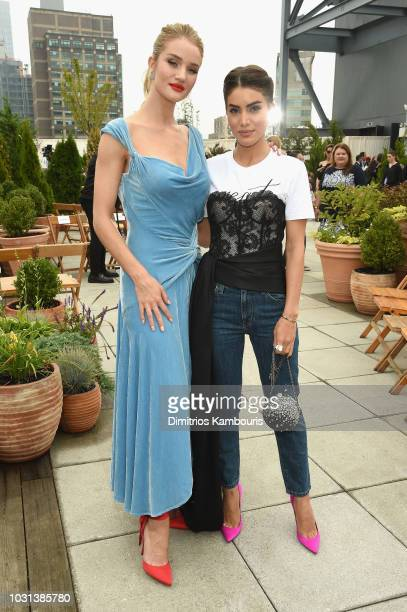 Model Rosie HuntingtonWhiteley and Camila Coelho attend the Oscar De La Renta front Row during New York Fashion Week The Shows at Spring Studios...