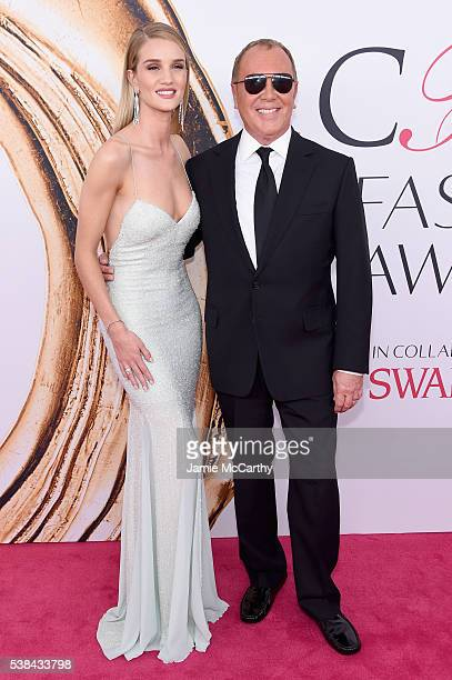 Model Rosie HuntingtonWhiteley and designer Michael Kors attend the 2016 CFDA Fashion Awards at the Hammerstein Ballroom on June 6 2016 in New York...