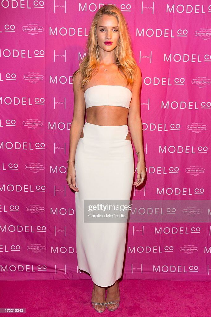 Model Rosie Huntington-Whiteley arrives at a black tie dinner hosted by ModelCo on Hayman Island in celebration of their new celebrity ambassador signing, Rosie Huntington-Whiteley on July 10, 2013 in Hayman Island, Australia.