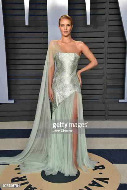 Model Rosie HuntingtonWhiteley attends the 2018 Vanity Fair Oscar Party hosted by Radhika Jones at Wallis Annenberg Center for the Performing Arts on...