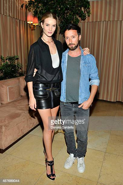 Model Rosie HuntingtonWhiteley fashion designer Anthony Vaccarello attends the FORWARD by Elyse Walker and Anthony Vaccarello dinner at Sunset Towers...