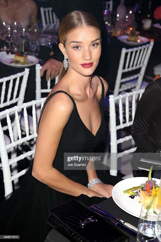 Model Rosie Huntington-Whiteley for FIJI Water At amfAR's Inspiration Gala Los Angeles at Milk Studios on October 29, 2015 in Hollywood, California.